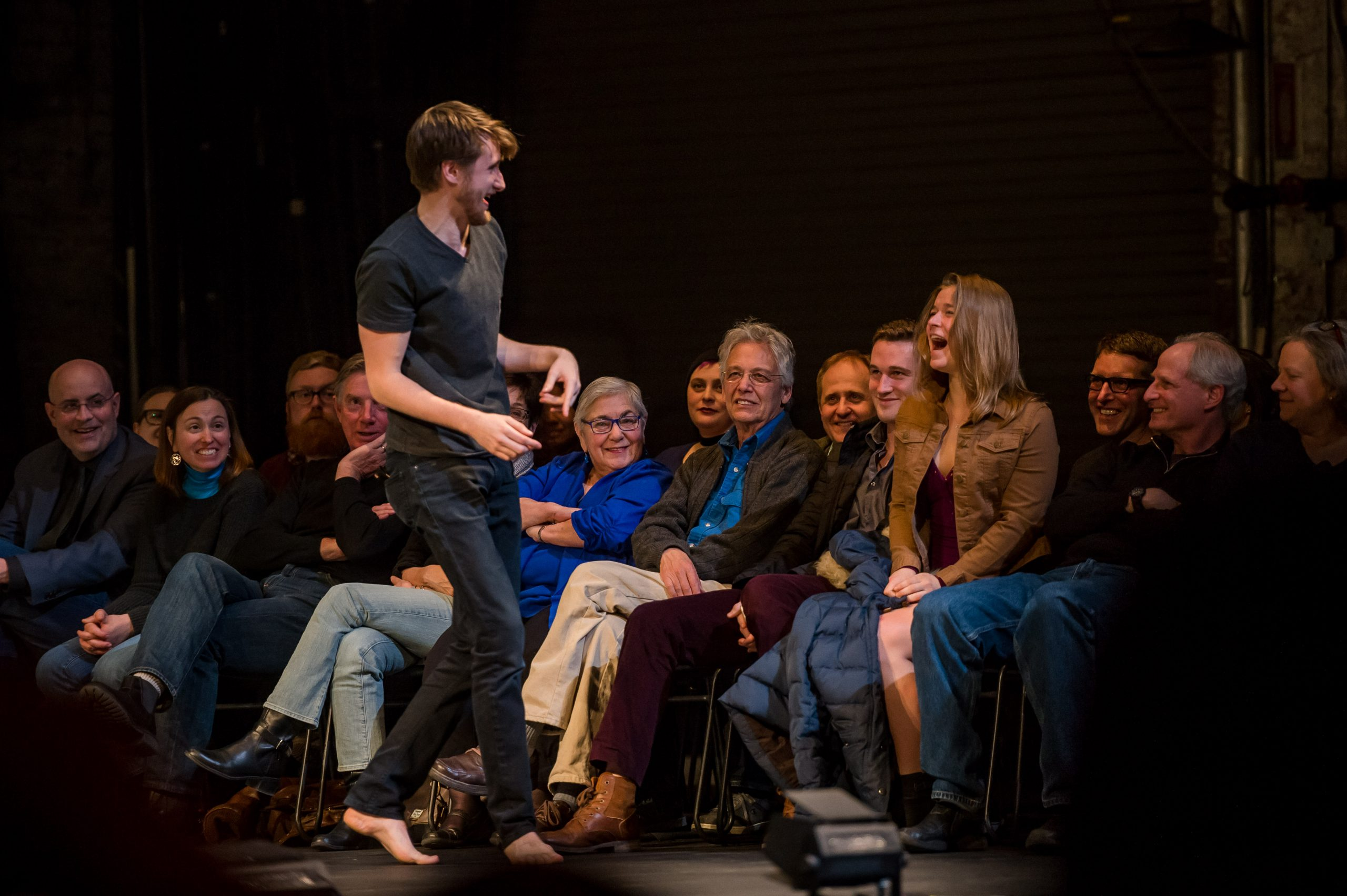 Actor interacting with laughing woman in the audience
