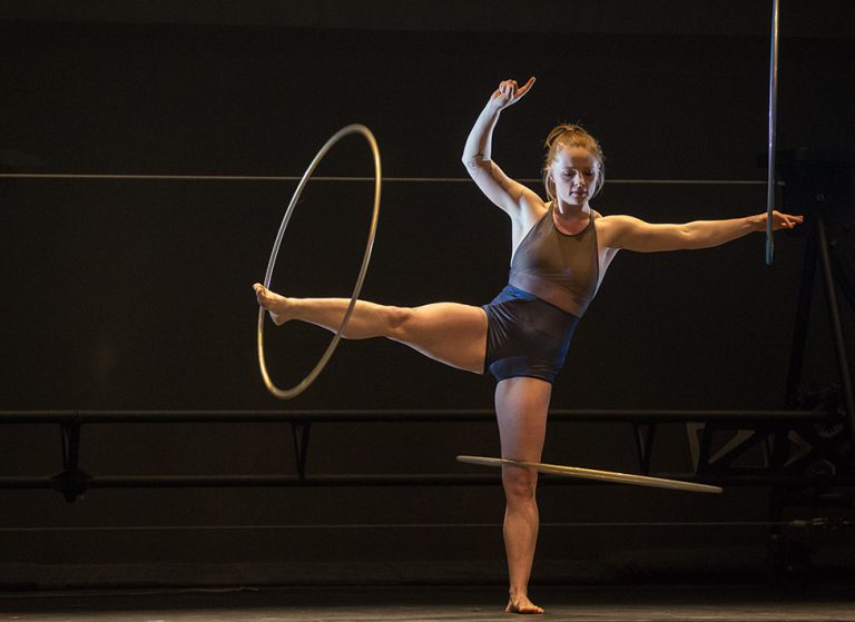 The 7 Fingers performer spinning hula hoops on her foot and leg