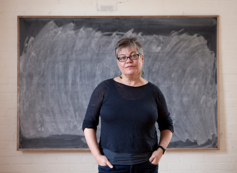 Alanna Mitchell standing in front of chalkboard