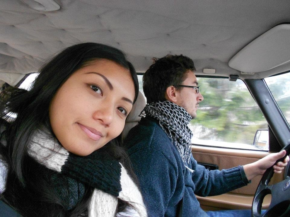 Smiling woman taking a selfie in the car while man is driving